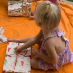 Mya makes short work of unwrapping her gift