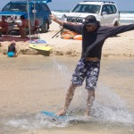 Anthony showing off his surfing skills at Ely Creek