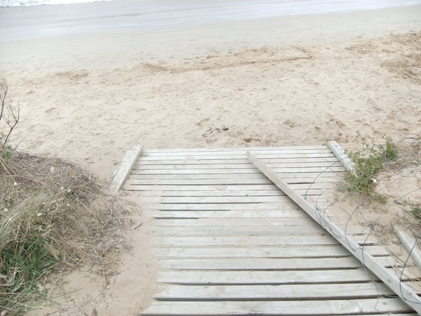 Broken path to the beach